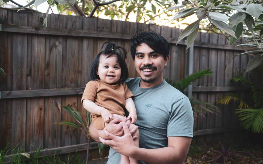 Portrait of dad and his baby daughter at their home.